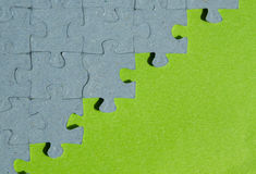 Jigsaw puzzle piece background with green background. With copy space Stock Photos