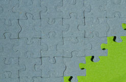 Jigsaw puzzle piece background with green background. With  copy space Royalty Free Stock Photos