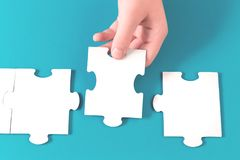 Jigsaw puzzle piece in a hand stock photos