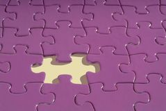 Jigsaw puzzle with a piece missing. A jigsaw puzzle with a piece missing Royalty Free Stock Photo