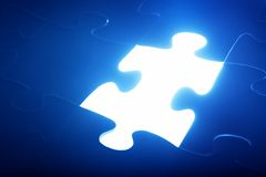 Jigsaw puzzle piece missing. Light glowing. Solution Royalty Free Stock Image