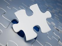 Jigsaw puzzle piece standing next to the missing part hole. 3D illustration.  Stock Photos