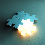 Jigsaw puzzle piece standing out. 3D-rendered jigsaw puzzle pieces, one of them glowing Royalty Free Stock Photo