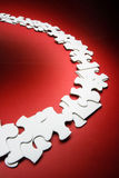 Jigsaw Puzzle Pieces. On Red Background Stock Image