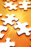 Jigsaw puzzle pieces. On orange background Stock Images