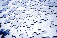 Jigsaw puzzle pieces. Scattered blue jigsaw puzzle pieces Royalty Free Stock Images