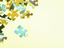 Jigsaw puzzle pieces. On a beige background Royalty Free Stock Image