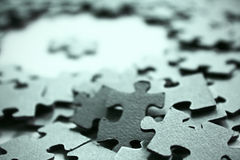 Jigsaw puzzle pieces. Cardboard jigsaw puzzle pieces closeup Royalty Free Stock Photos