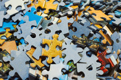 Jigsaw puzzle pieces. Task too difficult: pile of jigsaw puzzle pieces Royalty Free Stock Image
