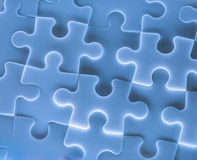 Jigsaw puzzle pieces as background. In closeup Royalty Free Stock Images