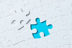 Jigsaw puzzle pieces on blue background Stock Photos