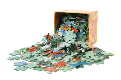 Jigsaw Puzzle Pieces and Box. On White Background Stock Photos