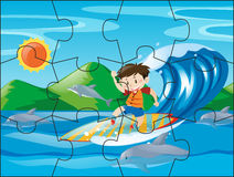 Jigsaw puzzle pieces for boy on surfboard royalty free illustration