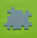 Jigsaw puzzle pieces on bright green background. With copy space Royalty Free Stock Photos