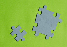 Jigsaw puzzle pieces on bright green background. Horizontal view with copy space Stock Photo