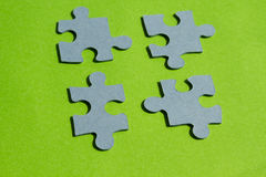 Jigsaw puzzle pieces on bright green background. Horizontal view with copy space Royalty Free Stock Photography