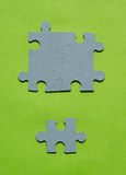 Jigsaw puzzle pieces on bright green background. Vertical view with copy space Royalty Free Stock Photography