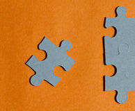 Jigsaw puzzle pieces on bright orange background Stock Images