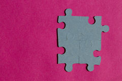 Jigsaw puzzle pieces on bright pink background Royalty Free Stock Photography