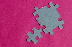 Jigsaw puzzle pieces on bright pink background Stock Image