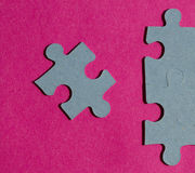 Jigsaw puzzle pieces on bright pink background Stock Photos