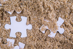 Jigsaw Puzzle Pieces Buried In Sand V Stock Photo