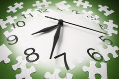Jigsaw Puzzle Pieces and Clock. In Green Tone Royalty Free Stock Image