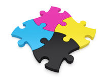 Jigsaw Puzzle Pieces CMYK. Jigsaw puzzle CMYK color jigsaw puzzle pieces on white background. Concept for any print related matters Stock Photography