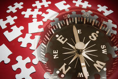 Jigsaw Puzzle Pieces and Compass Royalty Free Stock Photos