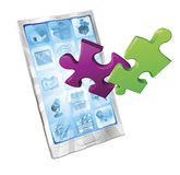 Jigsaw puzzle pieces flying out of phone Royalty Free Stock Photo
