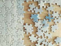 Jigsaw puzzle pieces. Half solved puzzle quest Stock Images