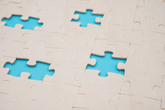 Jigsaw puzzle with 4 pieces missed on blue Stock Image
