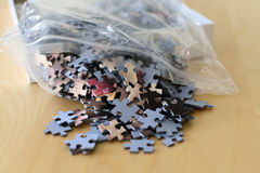 Jigsaw puzzle pieces out of the plastic bag Stock Photo
