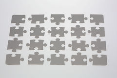 Grey Jigsaw Puzzle Pieces Royalty Free Stock Photography