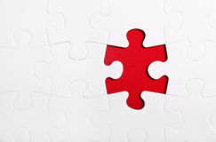 Jigsaw Puzzle. Pieces on the red background Royalty Free Stock Image