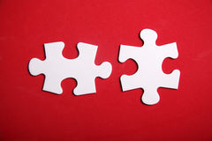 Jigsaw Puzzle. Pieces on the red background Royalty Free Stock Photo