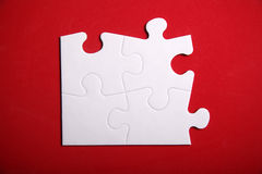 Jigsaw Puzzle. Pieces on the red background Stock Photos