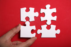 Jigsaw Puzzle. Pieces on the red background Royalty Free Stock Photography