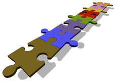 Jigsaw puzzle pieces in a row Stock Photos