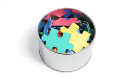 Jigsaw Puzzle Pieces in Tin. On White Background Stock Photography