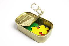 Jigsaw Puzzle Pieces in Tin Can Royalty Free Stock Photo