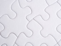 Jigsaw puzzle pieces. In white stock images