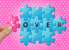 Jigsaw puzzle pieces with words lover Royalty Free Stock Image