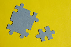 Jigsaw Puzzle pieces on yellow background Stock Photography