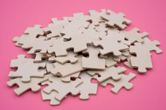 Jigsaw puzzle on pink background Royalty Free Stock Photo