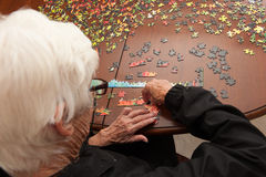 Jigsaw puzzle put together by an eldery woman Stock Images