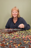 Jigsaw puzzle put together by a woman Royalty Free Stock Images