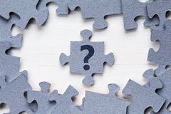 Jigsaw puzzle and question mark Stock Photos