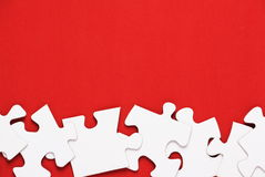 Jigsaw Puzzle on Red Stock Photos