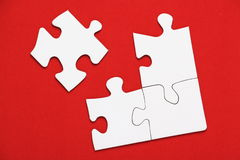 Jigsaw Puzzle on Red Royalty Free Stock Image
